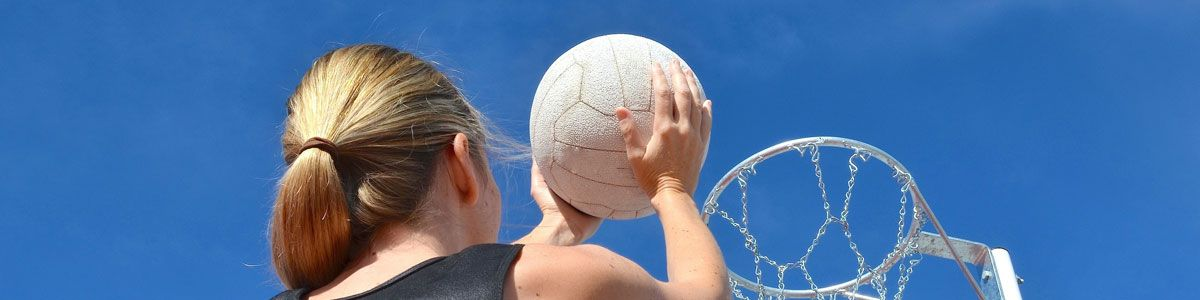 Girl taking shot in netball game